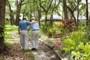 Lawrenceville companion care elderly man taking a walk with his caregiver companion.